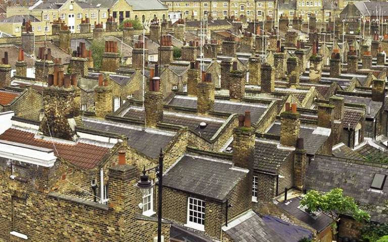 Photo of the view over the top of a number of houses in a town