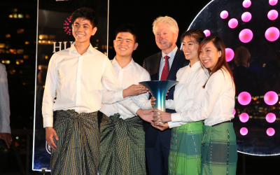 Winners of the Hult Prize 2018, Kisum Chan, Lincoln Lee, Julia Vannaxay and Vannie Koay, with President Bill Clinton