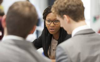 Group talking at an entrepreneurship event at BaseKX