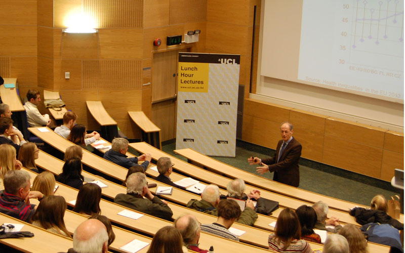 A lecturer at UCL teaches students in a lecture hall