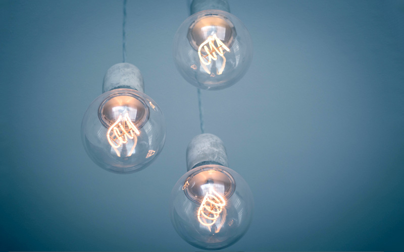 Three lightbulbs to symbolise collaborations and ideas
