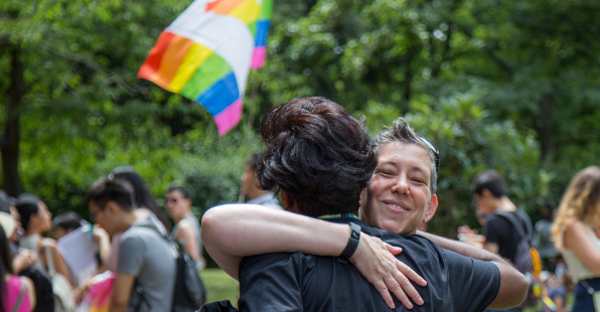 two guys hugging pride 2017