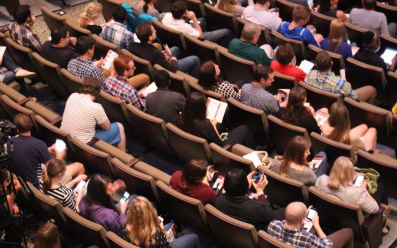 Aerial view of audience members in auditorium