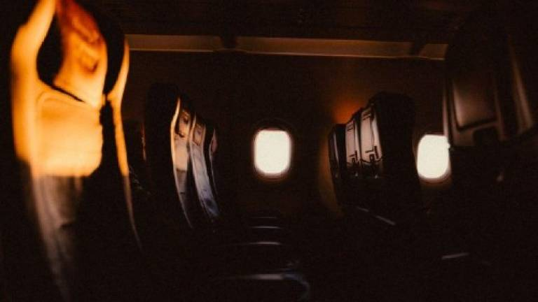 Photo of a row of empty seats on an aeroplane