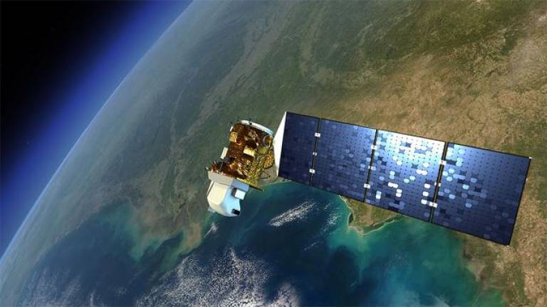 Image of a satellite orbiting round the earth