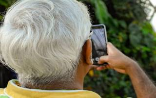 older person on phone