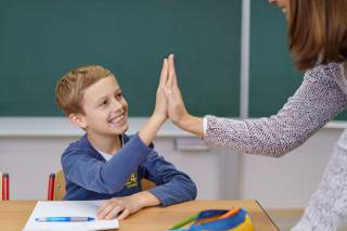 Young boy and teacher in the classroom