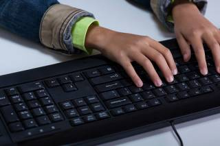 Hands using a computer keyboard