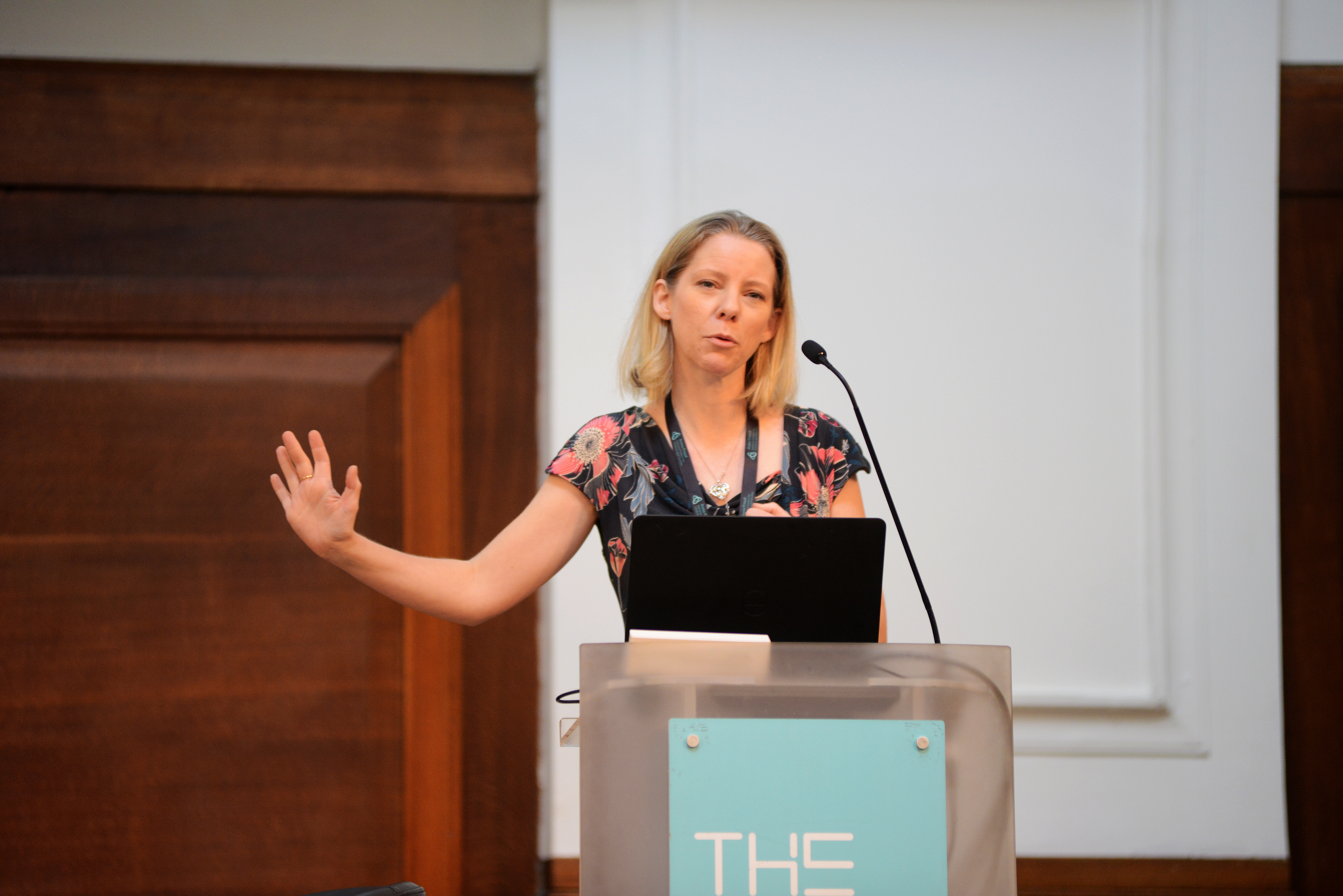 Woman speaking at a lectern