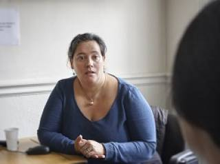 Woman speaking to someone across a desk