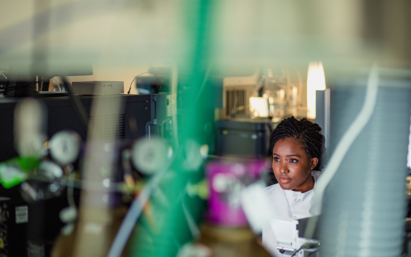 Researcher doing research in a business/laboratory setting