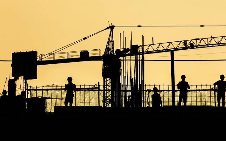 Silhouettes of construction workers