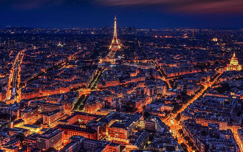 A night view of Paris featuring the Eifel Tower