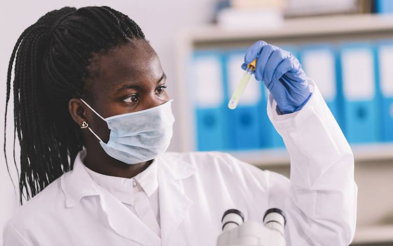 Female African researcher testing COVID-19 samples in a lab