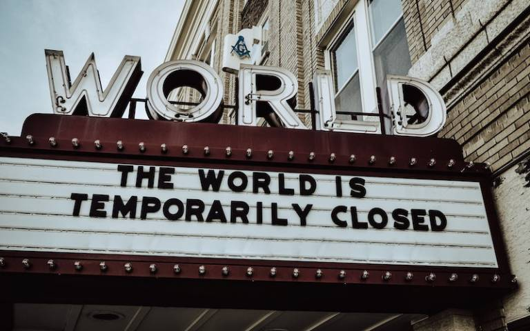 "movie theatre sign that reads ""The World is Temporarily Closed"""