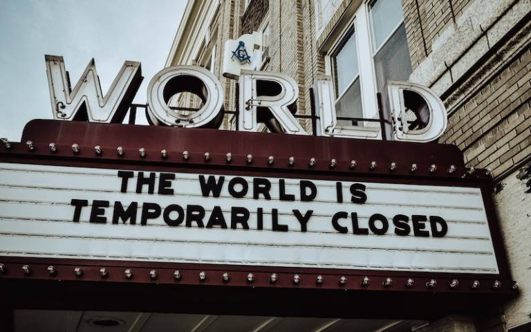 """movie theatre sign that reads """"The World is Temporarily Closed"""""""