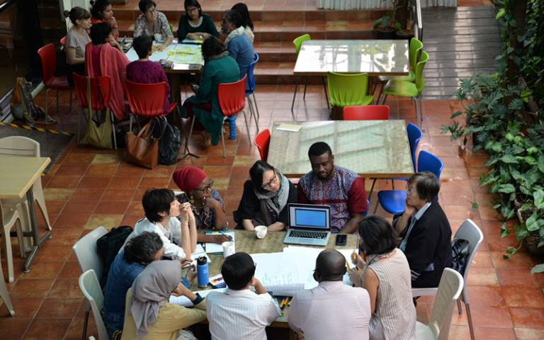 Attendees of the third annual KNOW workshop working together in Bengaluru, India