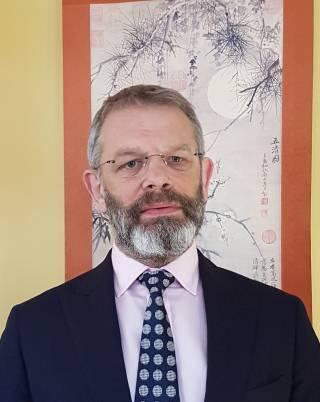 Dr Alun Coker