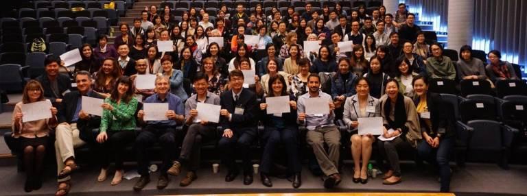 Group photo with representatives from UK, US, Denmark, New Zealand, Singapore, Italy, Brazil, Beijing, Taiwan, Macau, Malaysia, Thailand, and Indonesia.