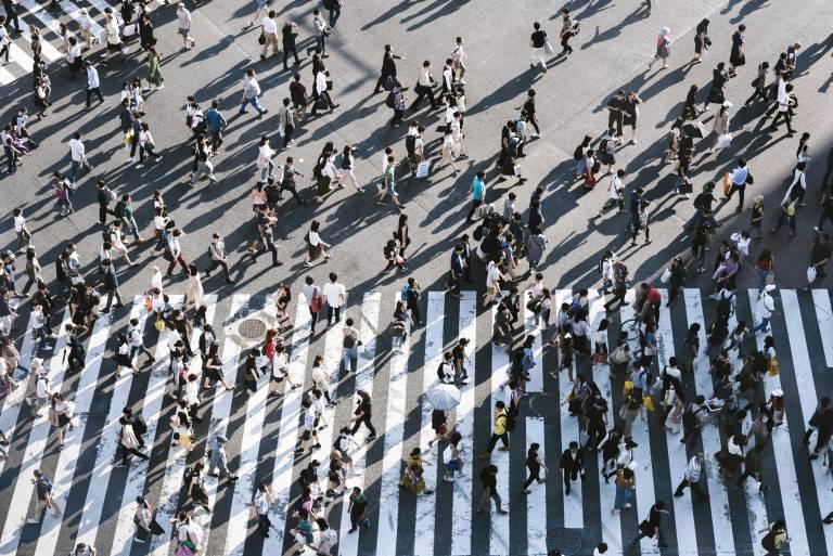People crossing a street aerial view