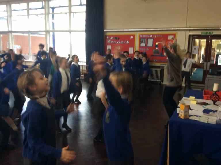 Children dancing during engagement activity