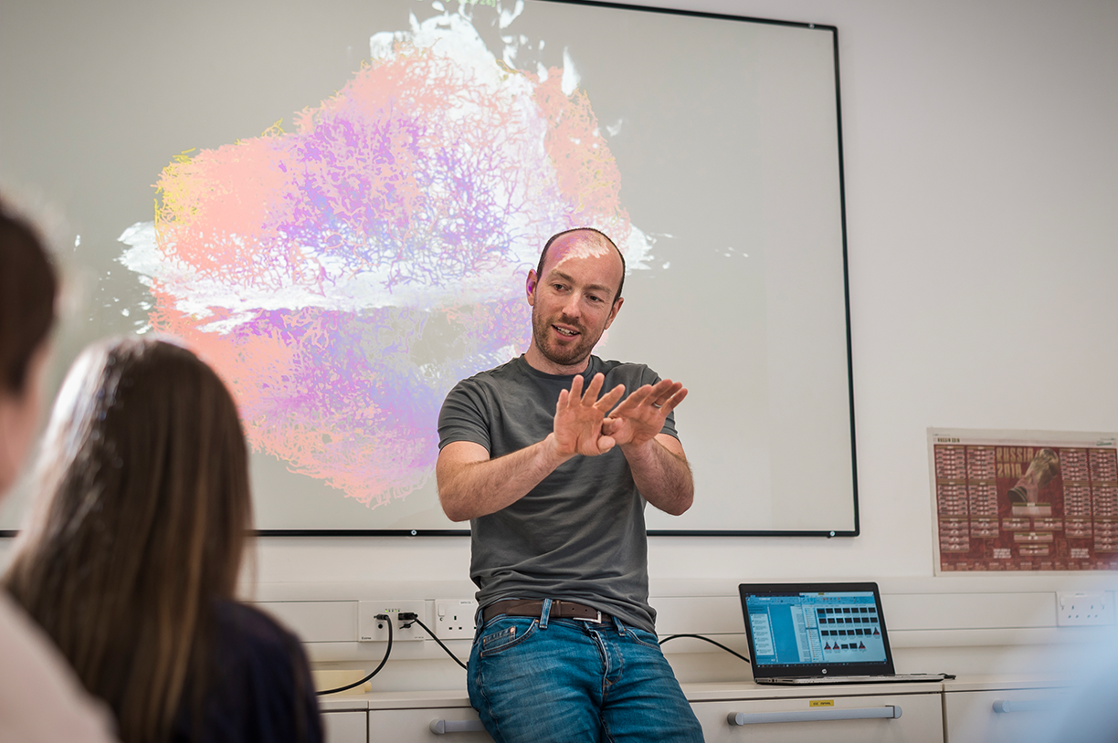 Diagnostics research | Simon Walker-Samuel in front of virtual tumour