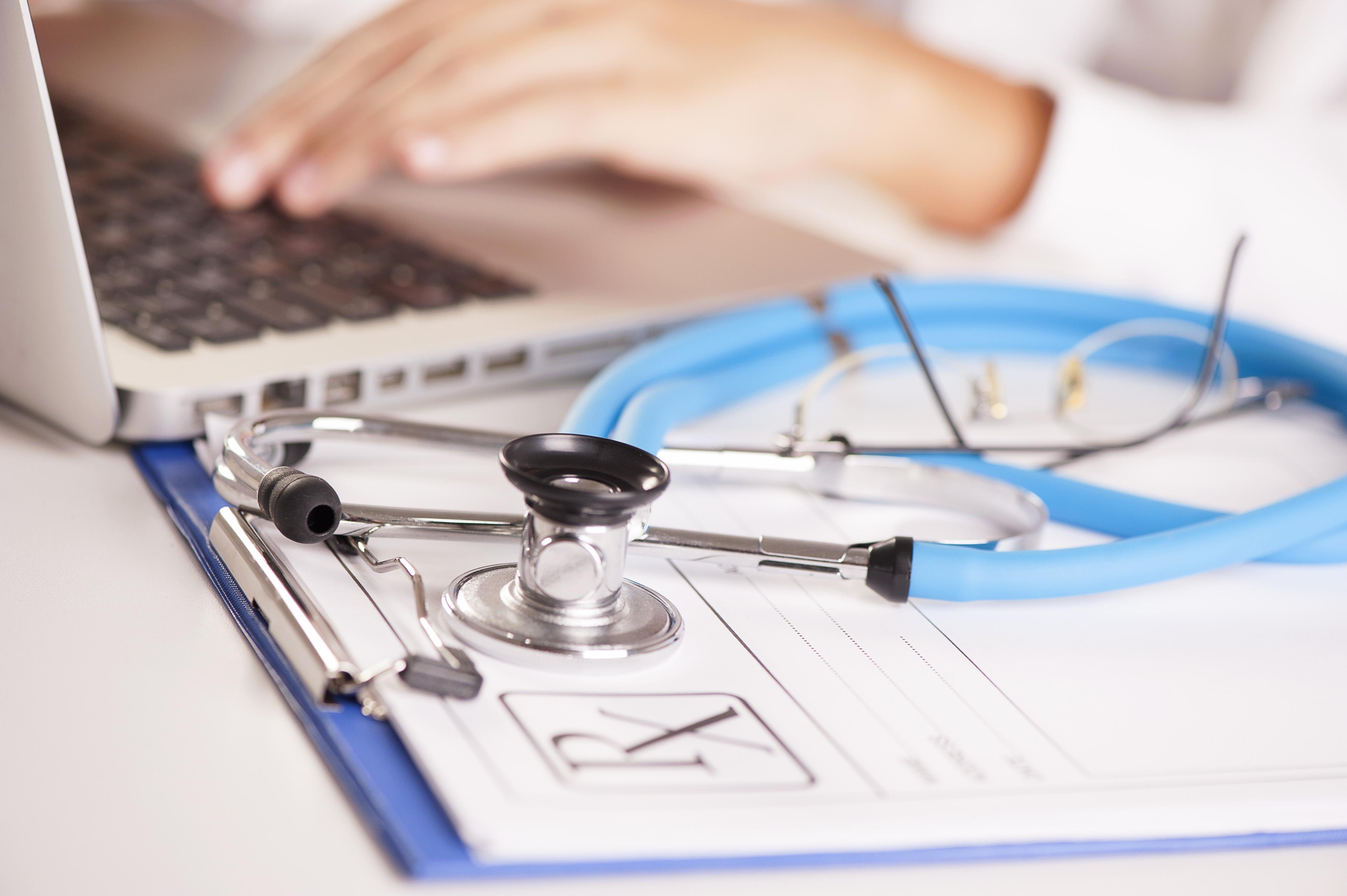 Clinician hands using laptop