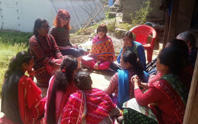 Researchers and a group of Nepalese women