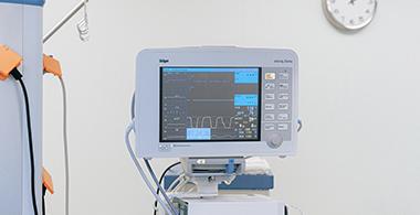 A heart monitor screen in a hospital