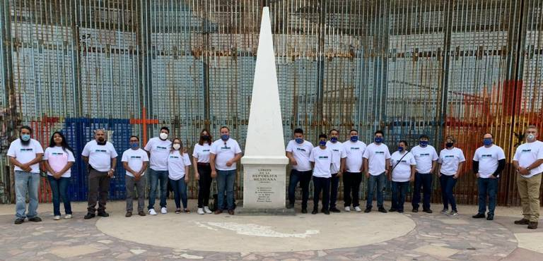 Baja Ventura members stand in Tijuana, on the US-Mexico border