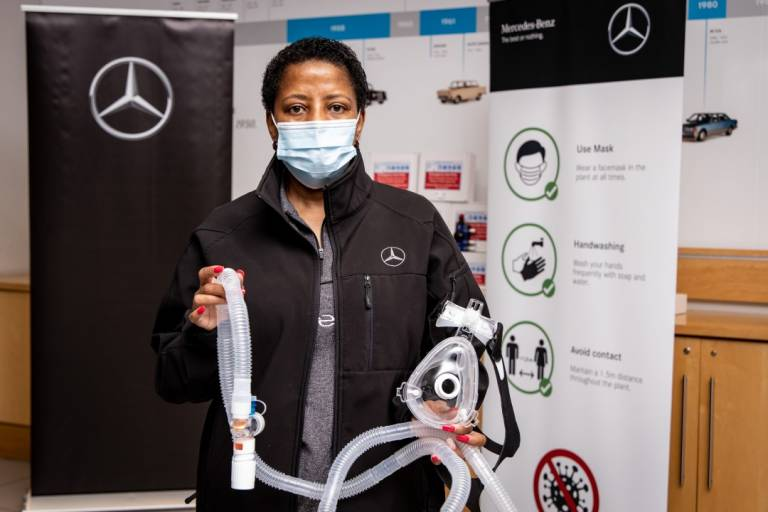 Mercedes-Benz South Africa employee holds a CPAP breathing circuit