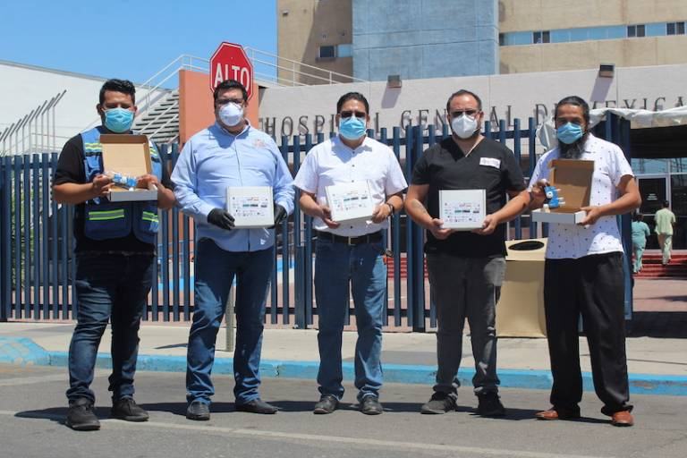 Baja Ventura members stand in front of Mexicali hospital