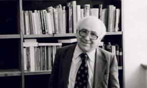 Chimen Abramsky in an office surrounded by books