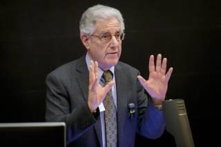 Prof David Ruderman gesturing while speaking to audience