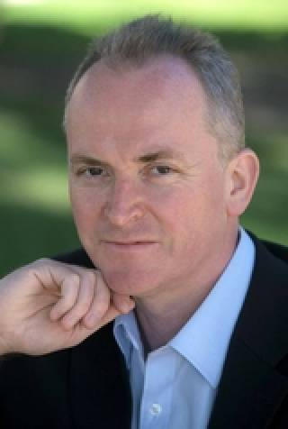 portrait fo Neill Lochery