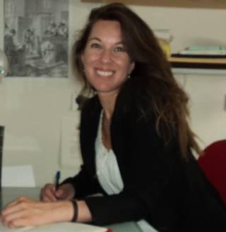snapshot of Alinda at a desk