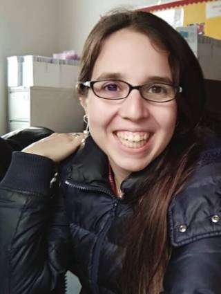 snapshot of Tamara at a desk