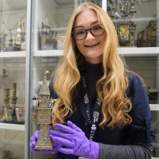 jemima in holding a jewish artifact