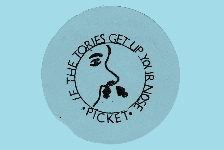 Badge depicting a nose with arrows pointing to the nostril. Border text reads, 'If the Tories get up your nose, picket'