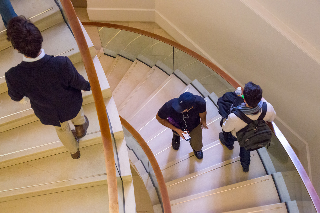 People on the staircase in the UCL main library, shown from above