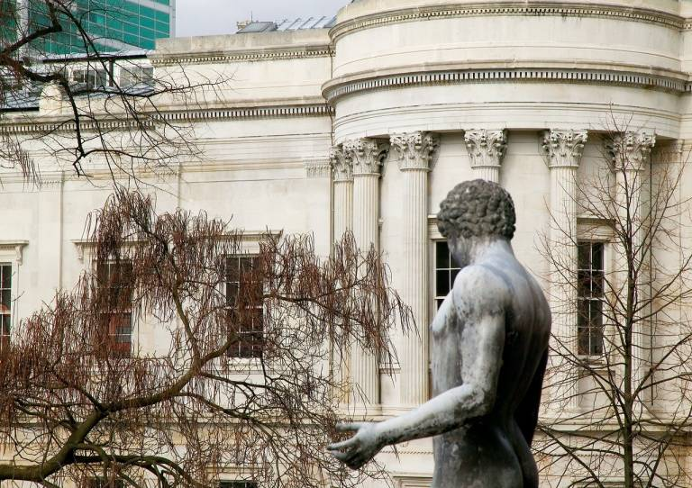 View of the UCL main building with a statue in the foreground
