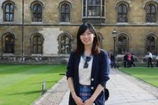 Image of Claudia Chang in front of an Oxford college