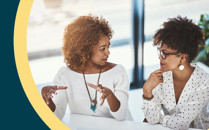 2 women sat next to each other talking