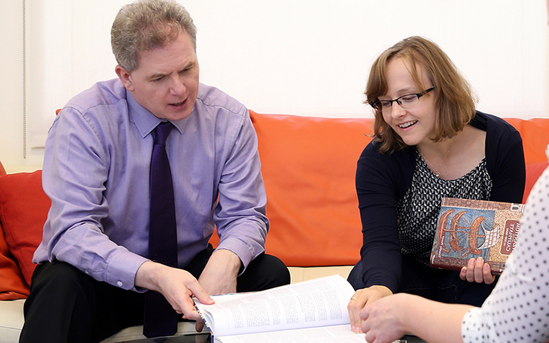 Two people looking at paper work