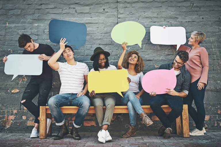 a group of people holding up speech bubbles