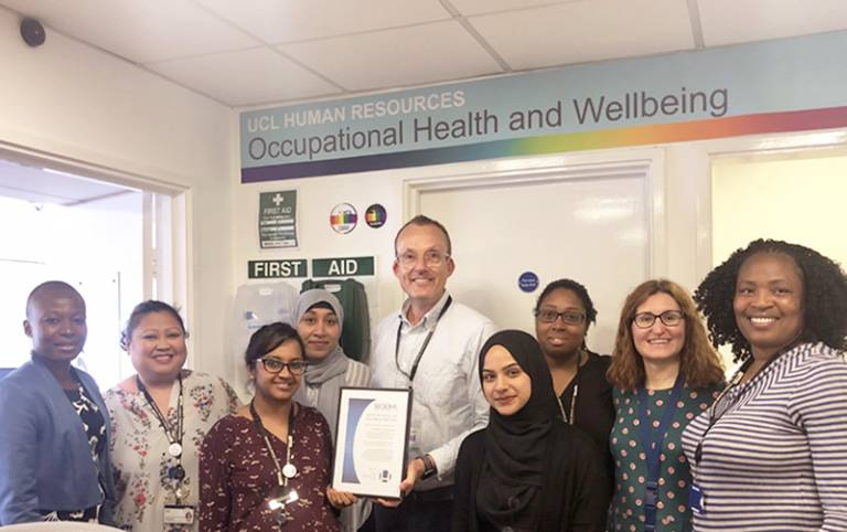 Occupational Health team holding award