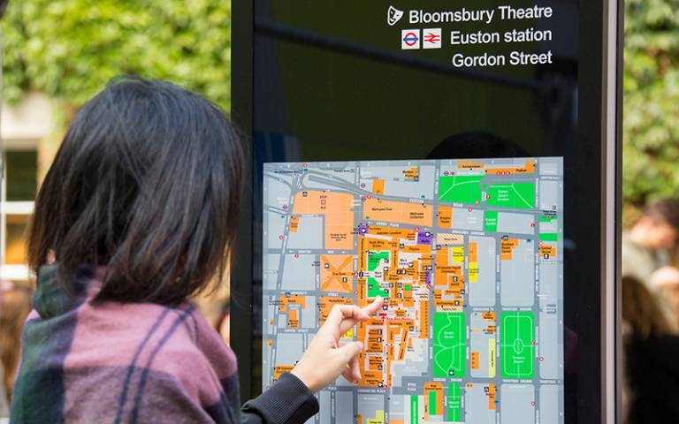 Woman looking at campus map