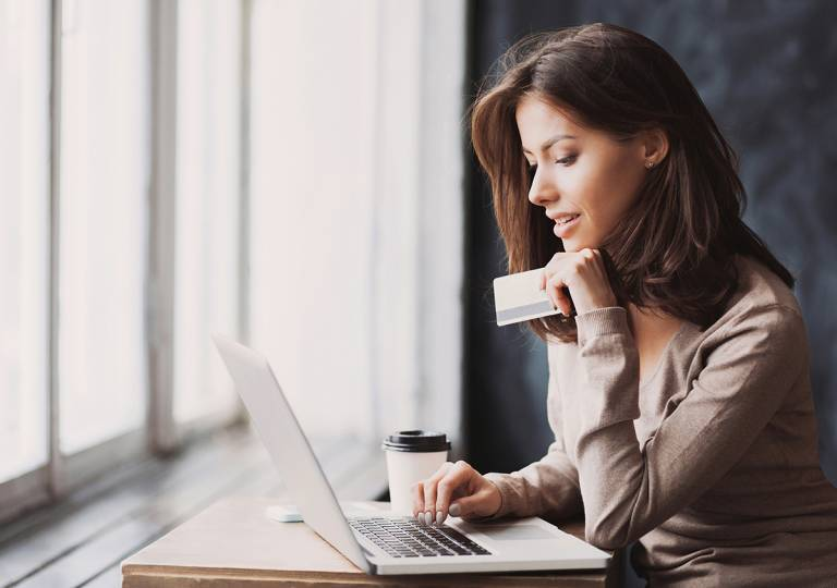 Woman thinking about financial benefits