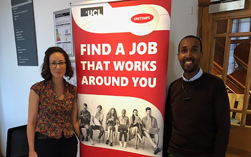 Staff standing next to Unitemps banner at launch event