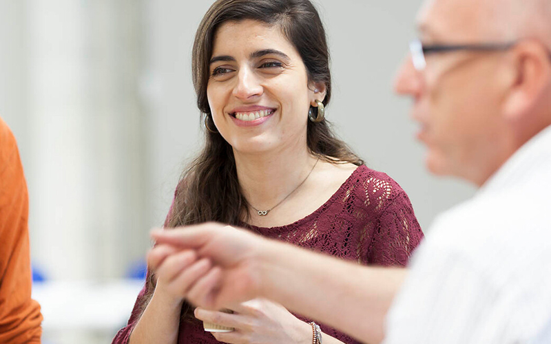 Woman smiling to talking to colleagues